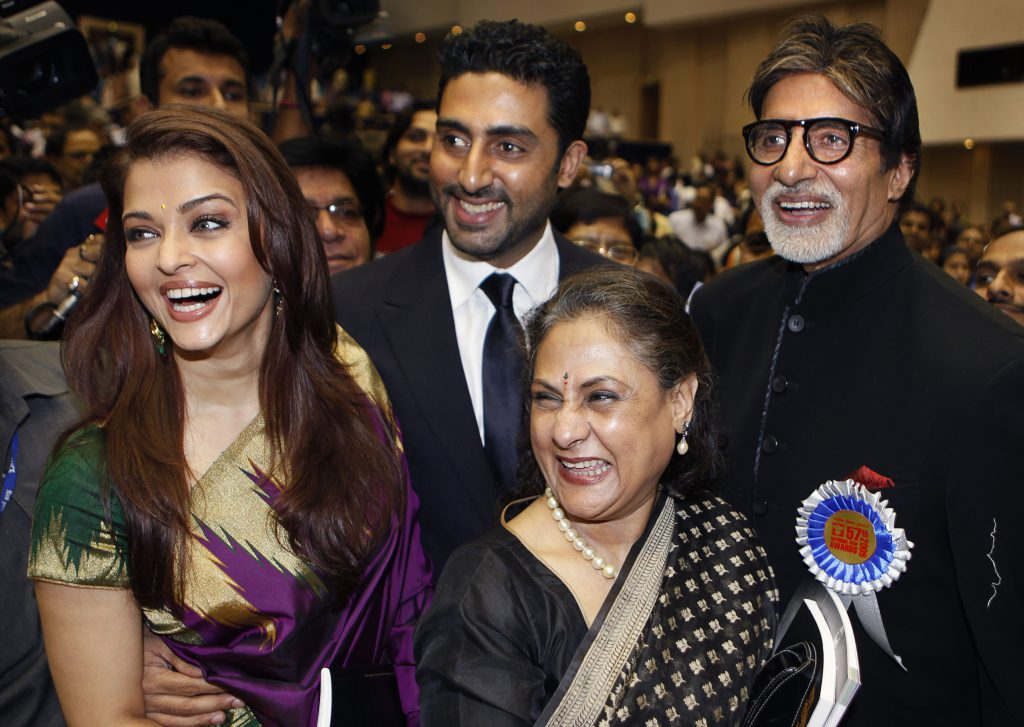 Bollywood actor Amitabh Bachchan, right, poses with his family members, from left, daughter-in-law Aishwarya Rai Bachchan, son Abhishek Bachchan and wife Jaya Bachchan, after receiving the award for the best actor during the 57th National Film Award ceremony, in New Delhi, India, Friday, Oct. 22, 2010. Bachchan received the award for his role in the film 'Paa'. (AP Photo/Manish Swarup) India National Film Awards