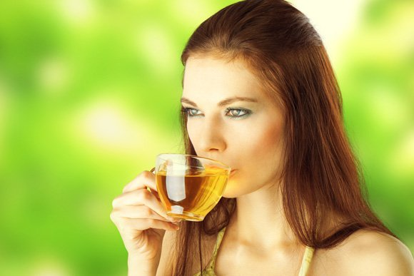 young-female-drinking-green-tea