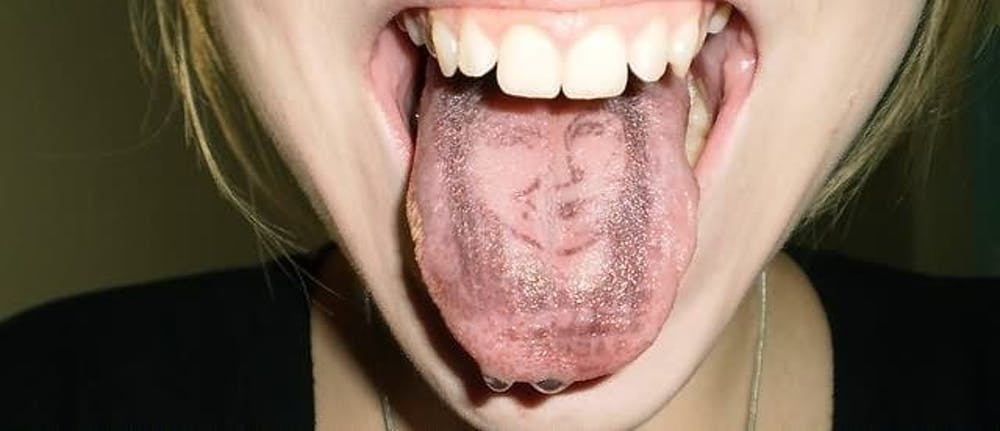 portrait tongue tattoo designs for women
