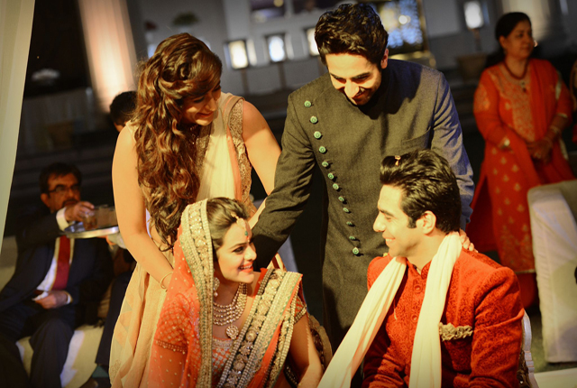 Ayushmann Khurana, brother of Aparshakti Khurana giving blessings to the couple on their wedding. Aparshakti Khurana wedding was a Punjabi style of wedding.