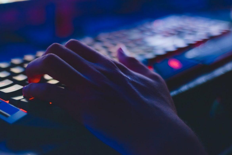 laptop typing hacker