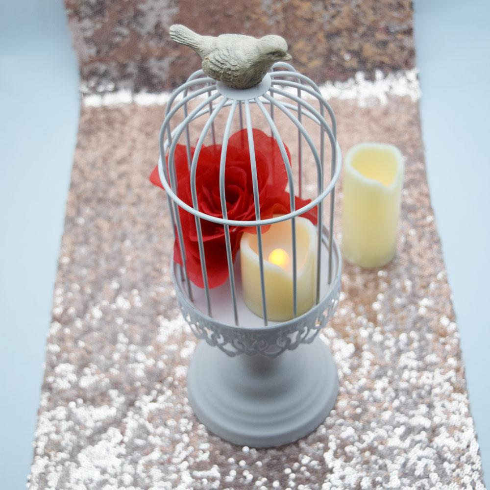 Decoration With Candles and Bird Cage
