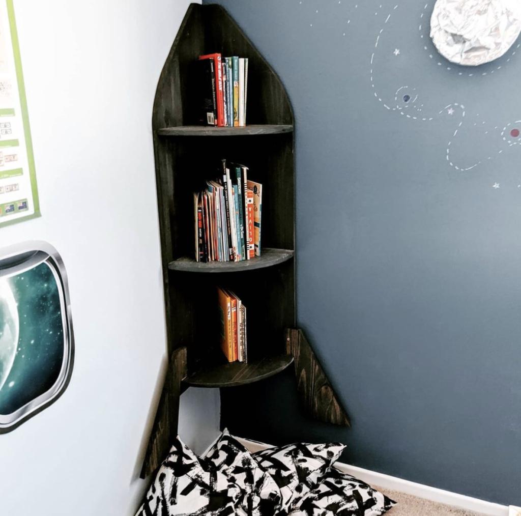 rocket shaped modern book rack design